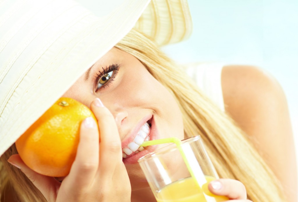 13356314 - young blond girl with orange juice